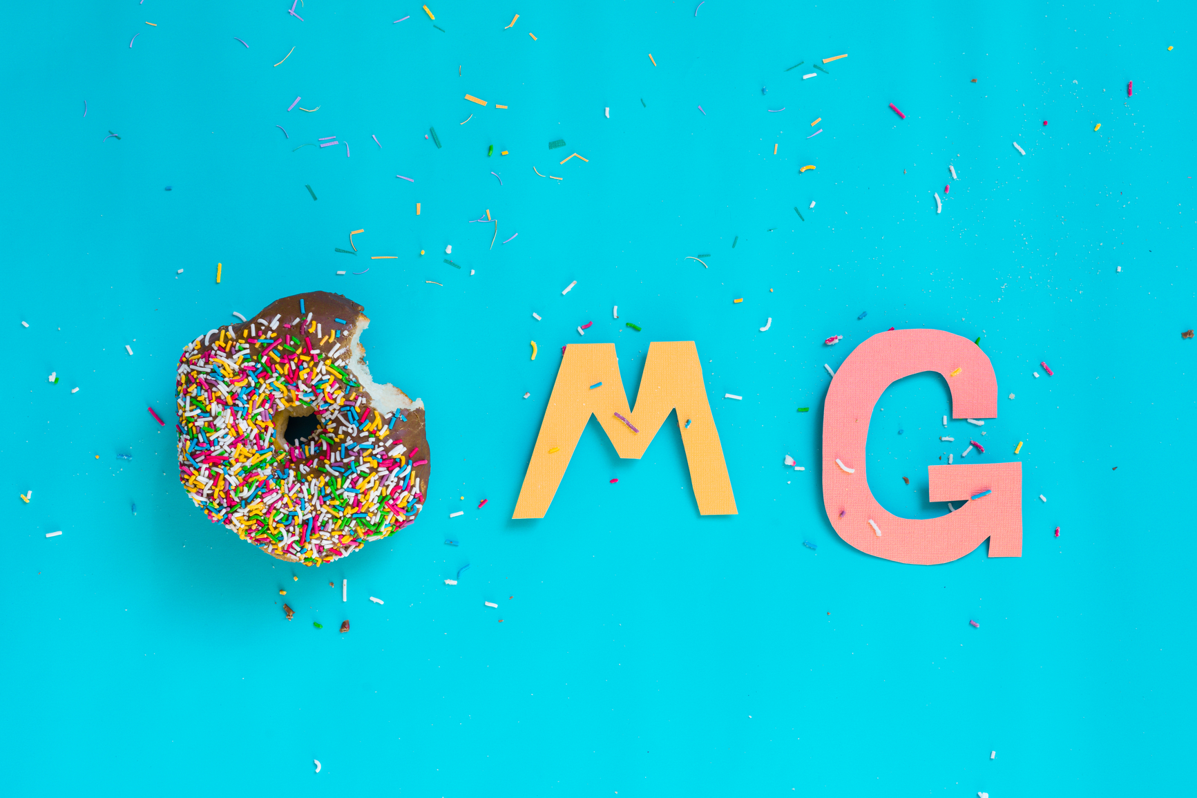 acronyms, OMG acronym spelt with doughnuts and paper cut-outs