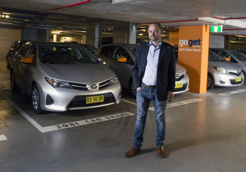 GoGet CEO, Tristan Sender, standing in front of GoGet car share spaces in Central Park development, Sydney